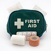 A green portable first aid kit with medical supplies