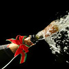 Champagne splash. Bottle and cork, with christmas decoration