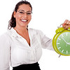 Young business woman showing a green colour clock