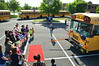 Kindergartners and family members listen as they learn about school bus safety durning K-Day at Walton Farm Elementary School.   Thursday,  August 7, 2014.   Photo by Geoff Patton