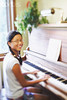 TA12.5 / Choice 2 of 14<br /> <br /> Teen Girl Playing Piano --- Image by © Ken Kaminesky/Take 2 Productions/Corbis