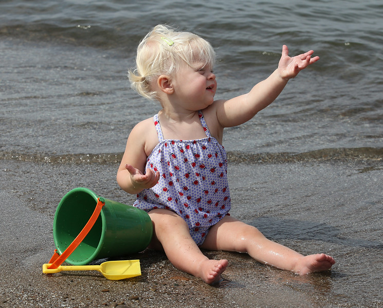 Kaylie Brown, age 1.5 yrs, beckons from the shore of Lake Erie in Vermilion on Labor Day. photo by Ray Riedel