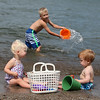Kaylie Brown, age 1.5 yrs and Shane Tucker, age 15 months, enjoy the beach while Shane's cousin Tyler Brown splashes in the lake in Vermilion on Labor Day. photo by Ray Riedel