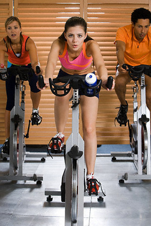 TA4.4 / Photo of mixed sexed group doing aerobic exercise  Choice 8 of 16  People on exercise bikes --- Image by © Image Source/Corbis