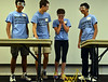 Katy Grace responds as the bridge she built with teammates Sidarth Giddu, left, Gordon Robertson, secolnd from left, and with Omkar Katta, right, collapses after addition of a weight during the spaghetti bridge building competition held at Montgomery County Community College.      Thursday,  July 24, 2014.   PHoto by Geoff Patton