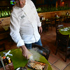 Mad Mex's Bill Fuller, Head Chef, spritzes a Shrimp and chicken fajita. Photo Pete Bannan