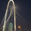 Full moon behind Margaret Hunt Hill Bridge, Dallas, Texas.