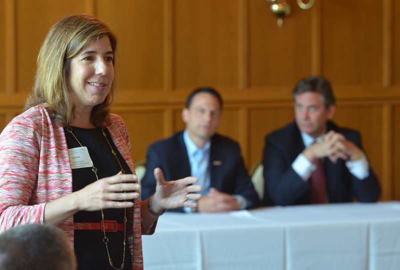 Montgomery County Commissioner Leslie Richards gestures while speaking to members of the PennSuburban Chamber of Commerce.  At center is Commissioners Chairman Josh Shapiro with Commissioner Bruce Castor Jr.   Wednesday,  June 18, 2014.   Photo by Geoff Patton