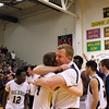 Ken Kadwell/@KenKadwell - Special to the Sun Mt. Pleasant senior Aaron Leasher (14) and head coach Dan Schell hug shortly after beating Flint Carman-Ainsworth for the Regional Championship at Mt. Pleasant Thursday, March 13, 2014.  Final score 64-61 Mt. Pleasant.