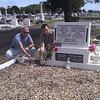 Simon and Michael scattering soil from Mt. Superbus on Mafalda Gray's grave at Townsville.