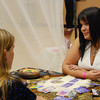 JosŽ Quezada/For the Times-Standard<br /> <br /> Khrystine Bugbee, RN, has her tarot cards read by Kendra Anderson. Bugbee is an Angel Therapy Practitioner and Reiki master.<br /> <br /> There was a whole lot of healing arts, massage and Reiki sessions, artists with energy focus, live harp music and just plain good vibes emanating from the Arcata Community Center as the 5th annual Synergy Fair opened on Saturday. The fair continues today.