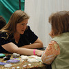 JosŽ Quezada/For the Times-Standard<br /> <br /> Kendra Anderson reads tarot cards set out for Tina Berns of Ferndale on Saturday. Anderson has practiced astrology and tarot for 20 years.<br /> <br /> There was a whole lot of healing arts, massage and Reiki sessions, artists with energy focus, live harp music and just plain good vibes emanating from the Arcata Community Center as the 5th annual Synergy Fair opened on Saturday. The fair continues today.