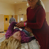 JosŽ Quezada/For the Times-Standard<br /> <br /> <br /> Virginia Taggert, a Craniosacral Therapist, works on finding balance for Jessica Bittner.<br /> <br /> There was a whole lot of healing arts, massage and Reiki sessions, artists with energy focus, live harp music and just plain good vibes emanating from the Arcata Community Center as the 5th annual Synergy Fair opened on Saturday. The fair continues today.
