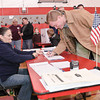 Scott Murphy Signs in to vote Tuesday Morning at the Glens Falls highschool. Photo By Eric Jenks 11/2/10