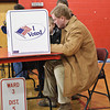 Scott Murphy picks his choices while voting in the Glens Falls highschool Tuesday Morning. Photo By Eric Jenks 11/2/10