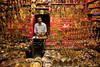 P1.6: Small business in India / to replace photo on page 13 of 9th edition<br /> Choice 12 of 12<br /> <br /> Vendor in Shree Menakshi Temple selling religious paraphenelia made from brass. (Newscom TagID: lpiphotos107940) [Photo via Newscom]