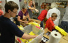 Christine Bouley, center, at work with  volunteers stocking  the Mattie N. Dixon North Hills Community Cupboard.    Tuesday, July 29, 2014.    Photo by Geoff Patton