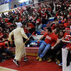 ''Moses'' played by Central Catholic senior Christopher Rizkallah parts a sea of red shirts as they cheer for their team during the game against Andover. 2/19/2014.