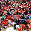 Central Catholic's faithful fans pretend to sleep during the introduction of the Andover players. 2/19/2014.