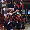 Central Catholic cheerleaders perform a cheer at half-time.  2/19/2014.