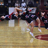 Central Catholic cheerleaders back flip across the gym while performing a cheer at half-time.  2/19/2014.