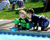 So what do you think these two are up to? Getting ready for the great splash marathon.Jack Josefowski, age 2 and Joe Aylmer, age 3 are planning some fun at the pool. Photo by Anne Neborak Delco News Network