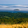 Fog rolling in over the islands in Bar Harbor, Maine. Image taken from Cadillac Mountain.