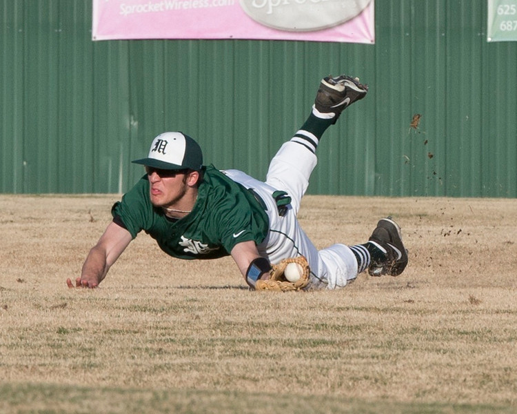 Muskogee right fielder Ethan Davis makes a diving catch to end the fourth inning against Sand Springs in the Roughers' home opener on March 11, 2014. MHS won 7-6.