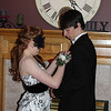 Emily pins the rose to Austin's lapel.