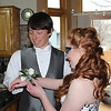 Austin helping Emily with her corsage.