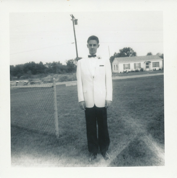 Ray standing in backyard of Grandparents on Swan Circle, Elsmere. Notice the homes still under construction in the background.