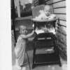 Mike Ware and Ray in folding high chair. Mary Ann Feldman owns this chair.