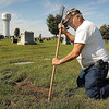 John Cross Tom Janni, caretaker at Calvary Cemetery in St. Peter, probes the depths of a hole left by marauding badgers. He estimates he has filled nearly two dozen of the holes left by the animals as they search for gophers over the last month.