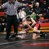 Adam Zimmerman, bottom, of St. Louis wrestles Austin Lalone of Farwell at St. Louis Wednesday, Dec. 11, 2013.  Lalone went on to win the match.  (Sun photo by KEN KADWELL/@KenKadwell).