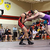 Adam Zimmerman, left, of St. Louis wrestles Austin Lalone of Farwell at St. Louis Wednesday, Dec. 11, 2013.  Lalone went on to win the match.  (Sun photo by KEN KADWELL/@KenKadwell).