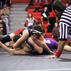 Jordan Crook, top, of St. Louis wrestles Anthony Love of Farwell at St. Louis Wednesday, Dec. 11, 2013. Crook went on to win the match.  (Sun photo by KEN KADWELL/@KenKadwell).