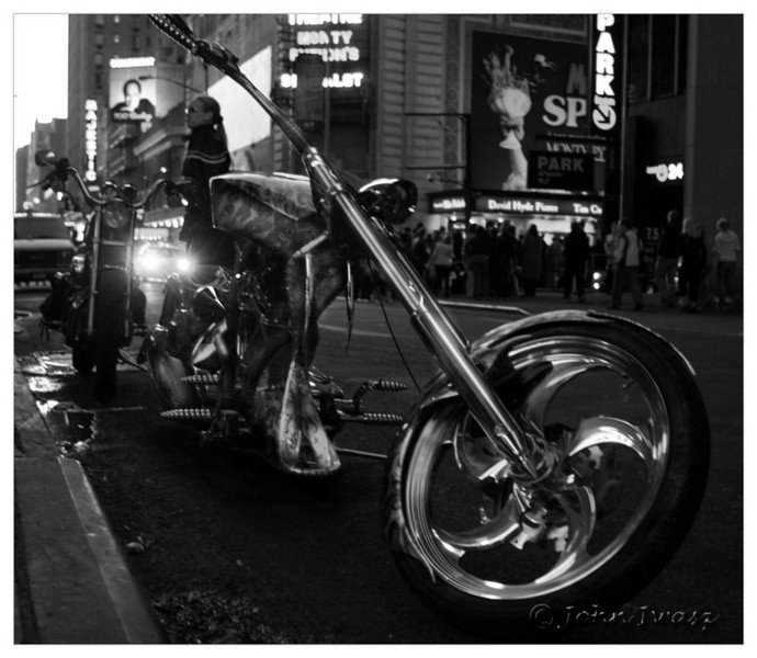 Taken somewhere near Times Square in New York. This hog looks like something put together on American Chopper. Looks good, but I bet the turning radius is about 9 degrees.