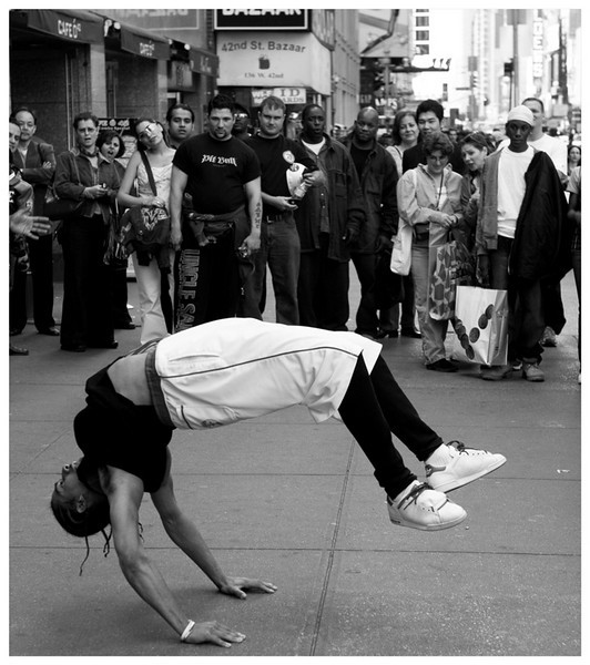 Talk about bending over backwards... No trip to New York is complete until you see a few street performers. Check out the crowd's reaction to his posture. This was not a backflip. He held himself like that for several seconds.   Posted to the CreamMe Group.