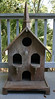 Large, wooden birdhouse.  This is a great decorator piece!