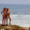 Two Swimsuit Bikini Models in Front of Surfers