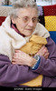 m628, TA15.36: characteristics of older U.S. adults living in poverty conditions. Choice 2 of 7  BX0RBE elderly woman keeping warm in winter wrapped up with a fleece blanket & hot water bottle in snowy conditions