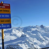 signpost indicating that only good skiers should proceed beyond this point