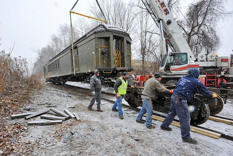 A work crew prepares a vintage rail car on a North Bennington side track Tuesday for transport to the Railroad Museum of New England in Thomaston, Conn. (Photo by Peter Crabtree)