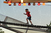 A child runs through an obstacle course at the annual Ambler Kiwanis Club Carnival at Wissahickon High School.   Friday, July 4, 2014.     Photo by Geoff Patton