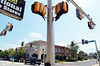 A motorist in Lansdale passes the newly installed traffic signal at Main and Wood Streets, which will go into flash mode on July 17 and into normal operations on July 22.     Thursday,  July 10, 2014.    Photo by Geoff Patton