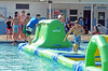 Youngsters at the Nor Gwyn pool in Upper Gwynedd race in pairs on on the Wibit, an inflatable floating obstacle course.  Thursday, July 10, 2014.  Photo by Geoff Patton