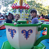 Amelie, Baxter and Caitlin on the tea cups at St Kev's fete