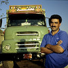 IRANIAN DRIVER POSING IN FRONT OF HIS OLD LEYLAND TRUCK