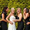 Fun photo of a bride and her bridesmaids at Kingswood Golf Club
