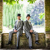 Groom and his best man sit on the wall at The Grange in Beddington Park